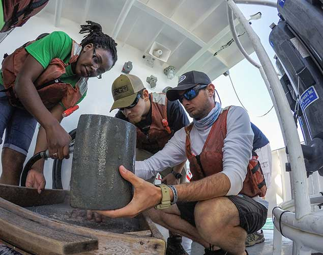 Photo of students learning on research vessel