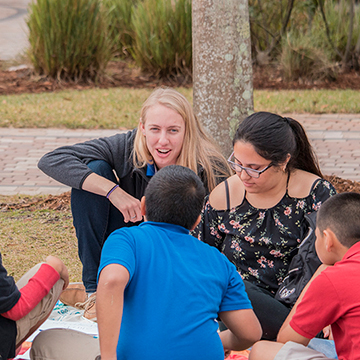 FGCU students teaching young children