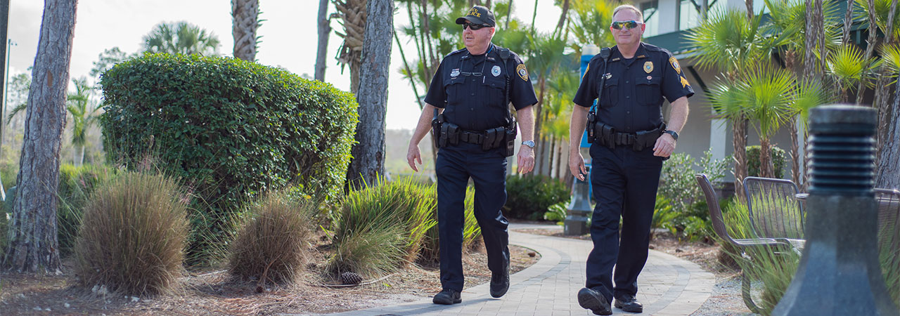 Photo of two UPD officers walking on campus